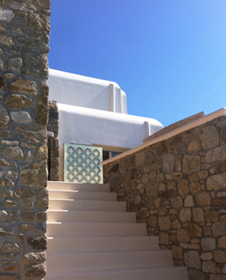 Special cut gold outdoor mirror panel in Mykonos