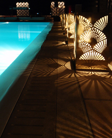 Mykonos poolside party lighting with gold metal lamps