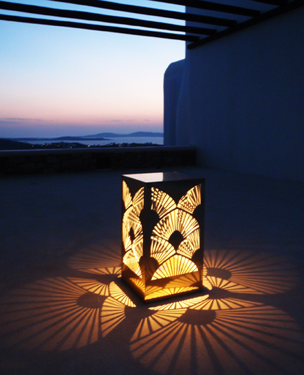Special cut gold mirror metal lamp in a Mykonos villa